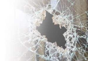An image of a smashed glass window