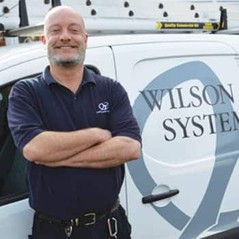 An image of a Wilson Alarm Systems employee named Woolman