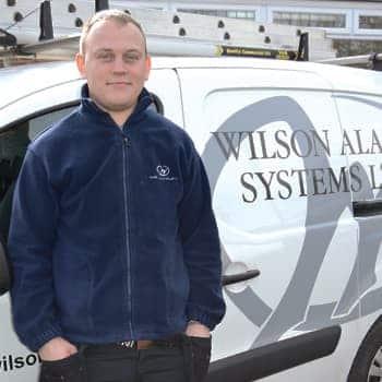 An image of a Wilson Alarm Systems Ltd employee names Krzysztof Kuchowicz