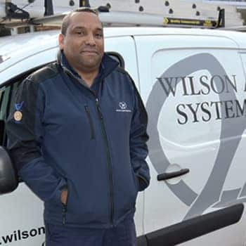 An image of a Wilson Alarm Systems employee named Leon Thomas