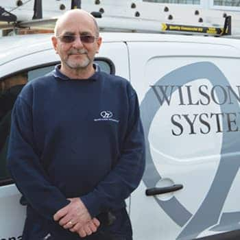 An image of a Wilson Alarm Systems employee named Tim Pumfrett