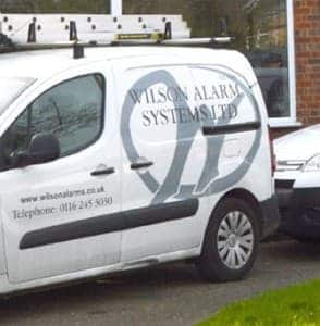 A image of a Wilson Alarm Systems Ltd Vehicle that is parked outside.