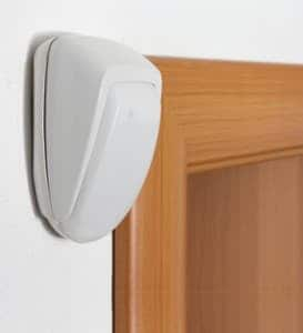 An image of a white alarm sensor in the home
