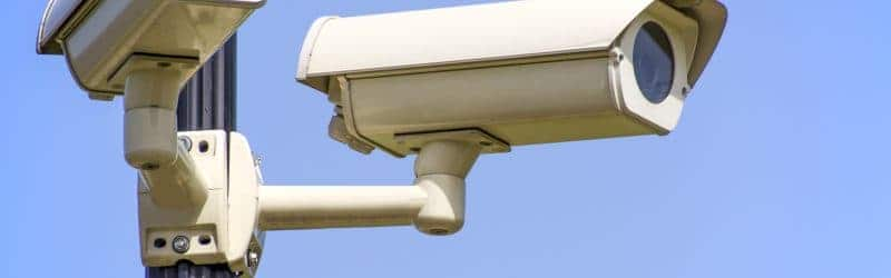 An image of CCTV camera systems with blue sky backround
