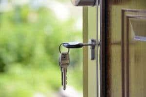 Keys in a lock on an open front door