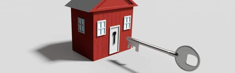 An image showing a secure toy house with a large key ready to open the door.