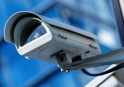 An image of a cctv camera mounted on a wall.