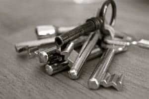 An image of a set of silver keys on a table in a house.